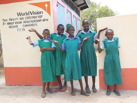 Pupils of Ngunini Primary School in Kenya's Makueni County outside the new toilet block constructed with support from World Vision. ©World Vision Photo/Hellen Owuor