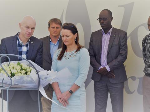 Leaders of world Vision paying their respects at Gisozi memorial