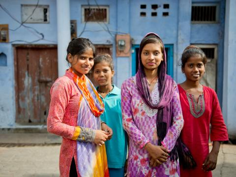 A group of Indian girls standing in an urban setting