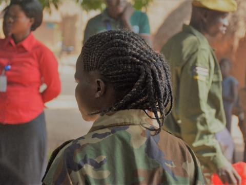 girl child soldier in camo gear