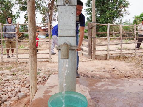 AHAN staff showing new borehole usage