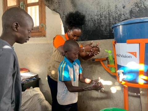 Antoinette Habinshuti, World Vision Senegal National Director doing handwashing lesson with children
