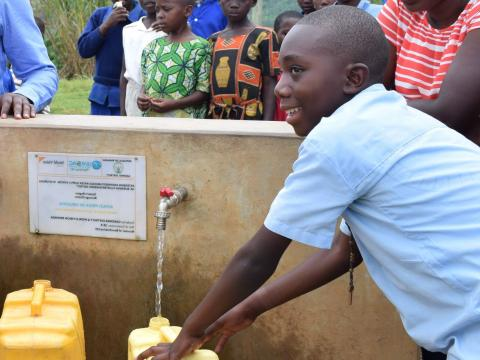 Lambert fetching clean water constructed close to his home