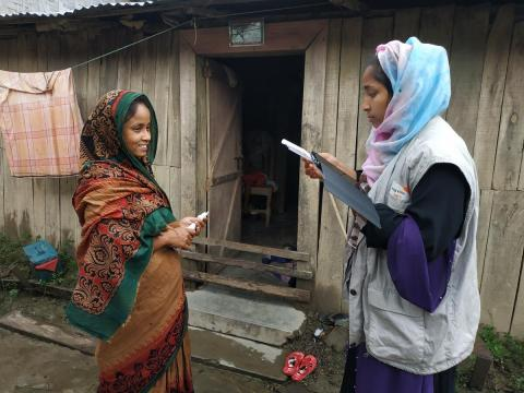 Beneficiary registering for cash assistance after floods affecting Bandarban, Bangladesh