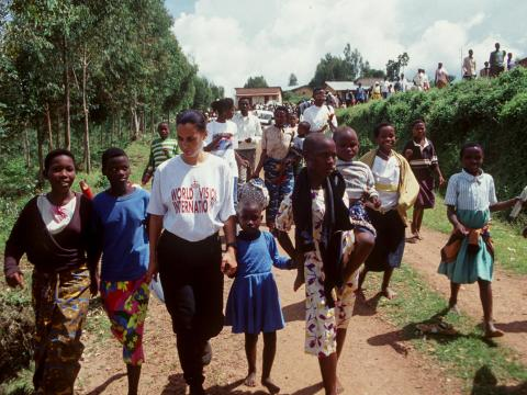 World vision Staff and Hidden Hero walks with displaced children