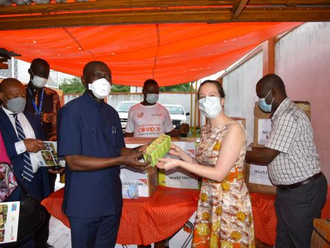WV DRC National Director, Anne-Marie Connor, hands over an assortment of medical supplies to government to fight COVID19