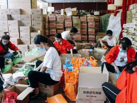 World Vision staff and partners packing relief packages for children and families during COVID-19