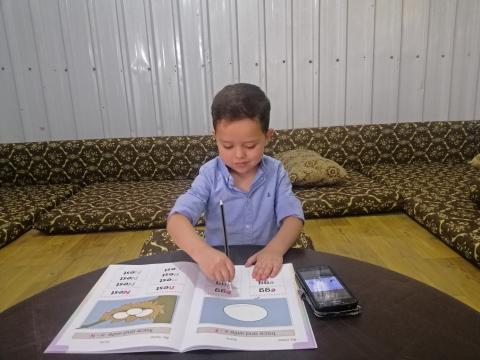 Five-year-old Qutaibah, a participant in our ECD programme at Azraq Refugee Camp is studying remotely due to COVID-19 lockdown