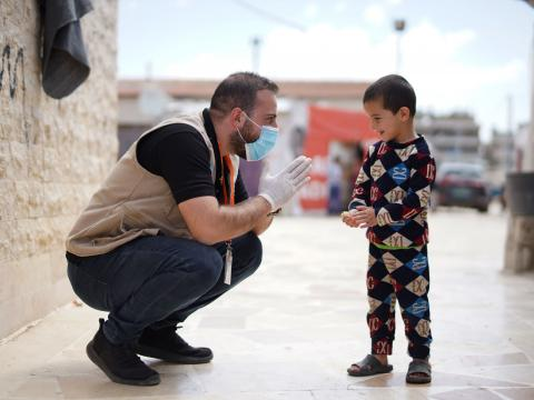 The WASH team reminds Syrian refugee children of the handwashing steps