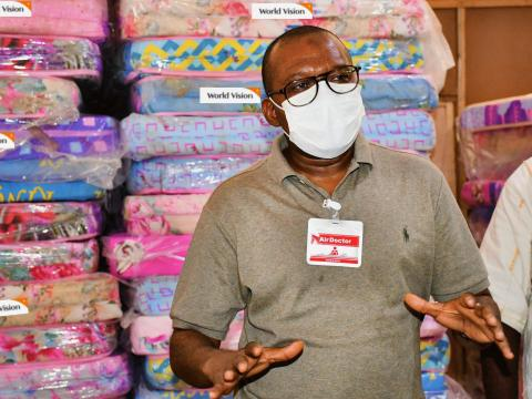 Dr. Mohamed Juldeh Jalloh, Vice President of the Republic of Sierra Leone receiving World Vision's donations to quarantine facilities