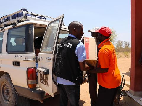 World Vision staff delivering RUFT to a health centre