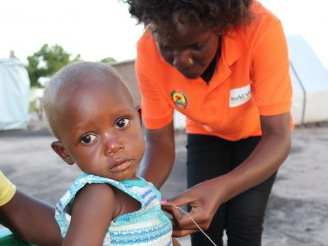staff takes care of child during Cyclone Idai