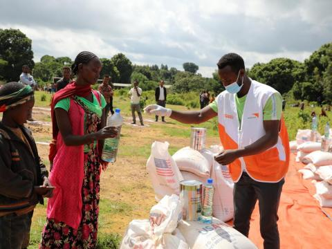 World Vision staff distributes food in Ethiopia