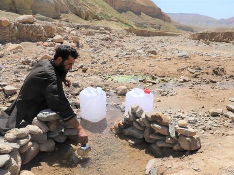 Ghani is fetching water.