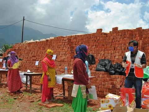 WVI Nepal staff facilitates food and hygiene kits distribution at a brick factory in Kathmandu on June 8, 2020.