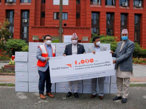 National Director Janes Ginting hands over 1,000 PPE and 120 Infrared (IR) thermometers to the Ministry of Health and Population (MoHP) on April 22, 2020.