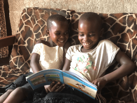 Kellen(right side) and her little sister cheerfully reading