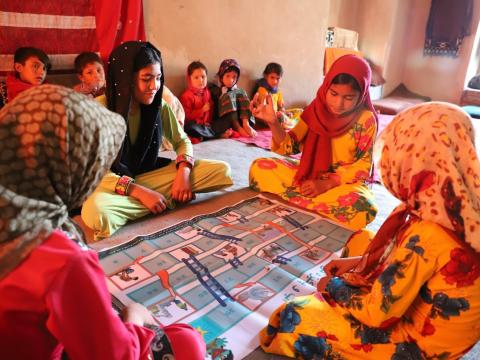 Girls are happy for playing chutes-and-ladders