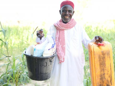 elhaj katchalla with the materials he received from WV