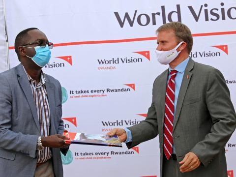 Sean Kerrigan,World Vision Rwanda National Director presenting handover documents to Dr. Daniel Ngamije,Rwanda's Minister of Health