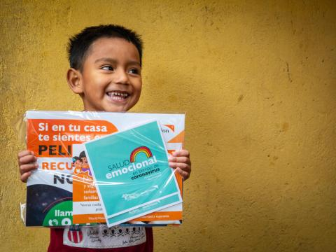 Boy in Ecuador with educational materials