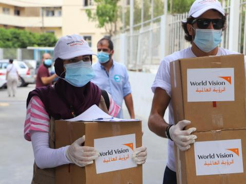 World Vision staff in Lebanon carry boxes of emergency supplies to those affected the the tragic explossion in Beirut
