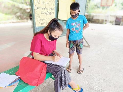 Mae, 18 teaches children in her community in Philippines to read during COVID-19 lockdowns