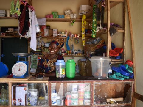 Josiane happily waiting for clients in her shop
