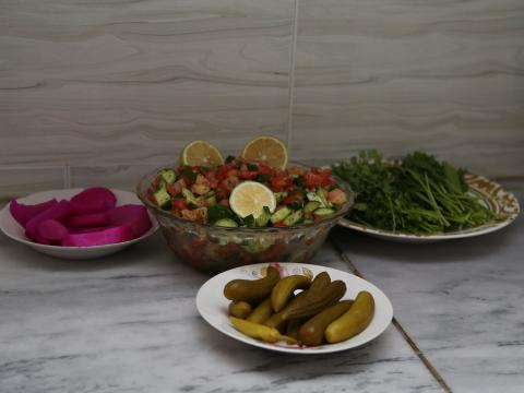 Full shot of the salad and pickles to be served with the main dish.