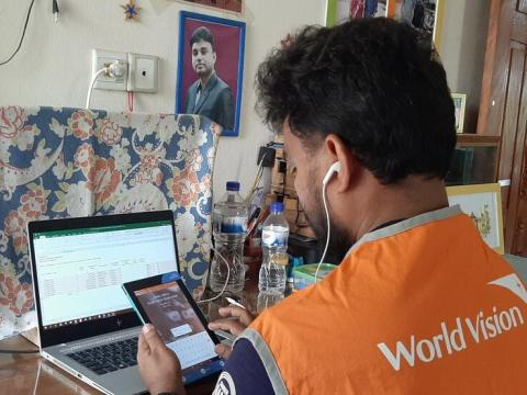 World Vision staff member works on technology