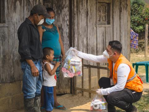 World Vision staff distribute food to families in Need in Honduras