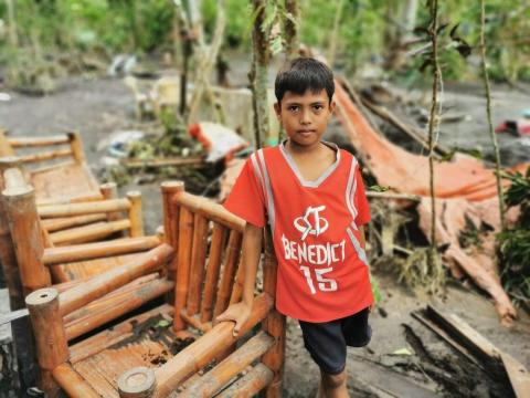 11-year-old Mico's home was buried in mud after Typhoon Goni