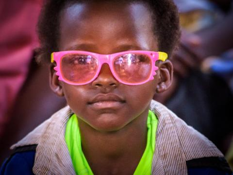 Child in pink glasses