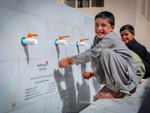 Happy face of Milad for water.