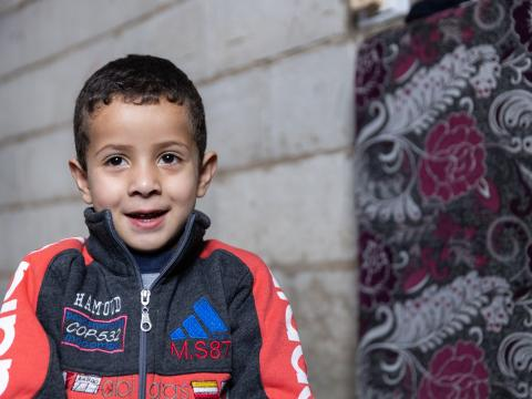 Baraa, four-year-old Syrian refugee boy, enrolled in remote early childhood education session with WVL in Bekaa