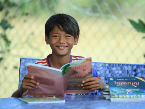 Sponsored child Chamrong loves learning at the reading club.