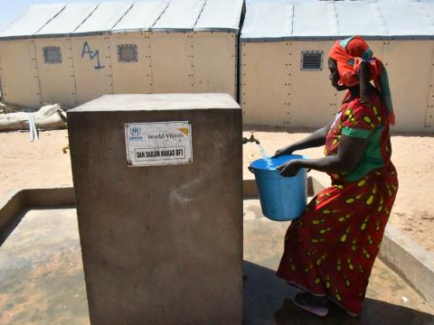 Amina fetches water at the pump