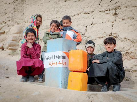 Children with Jerry cans of clean water in Afghanistan