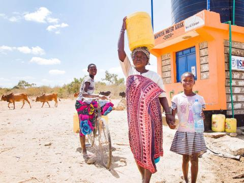 World Vision enhances access to clean water.Dama and her children Sidi and Saumu fetch water for their use in Mapotea, Kilifi County Kenya