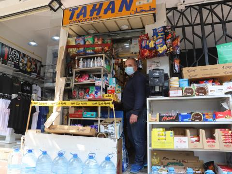 Khalil Tahan standing in front of his small shop