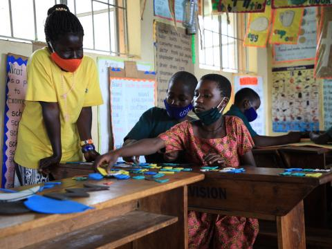Maria in her print-rich classroom. World Vision supports the initiative of improving the classroom environment to boost learners' experience.