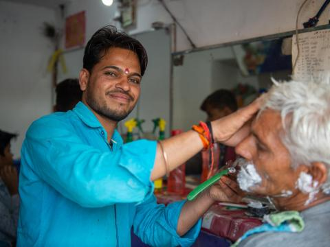Hemant started his barbershop 13 years ago with a kit from World Vision India