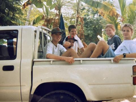 Andrea in a van with other teens