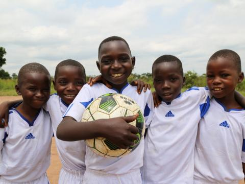 Boys play soccer at World Vision's Child Friendly Space in Kasai