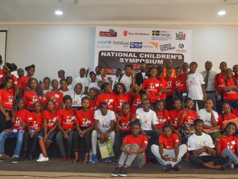 Children pose for a picture at the children symposium