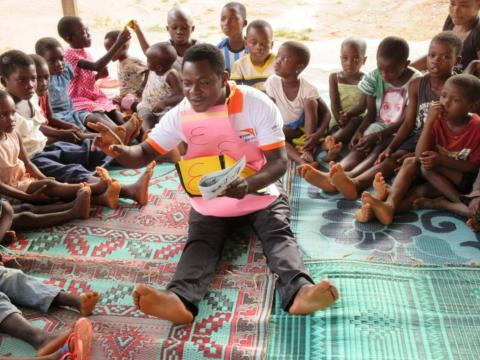Elijah reads to children at a World Vision reading camp in Ghana