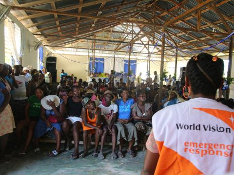 World Vision staff conducting awareness session on hygiene and cholera prevention in the communities affected.