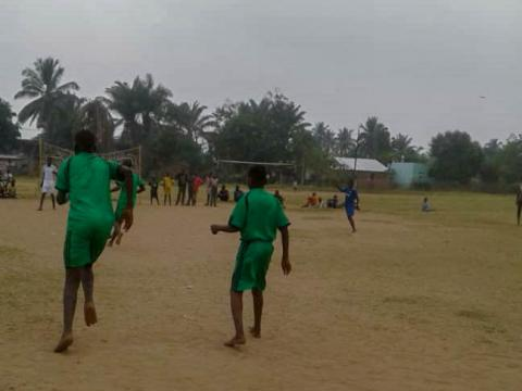 Albert* plays football with other children at World Vision's Child Friendly Space