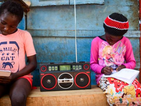 Listening to the teaching on the radio in Sierra Leone