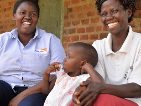 World Vision staff and mum laughing